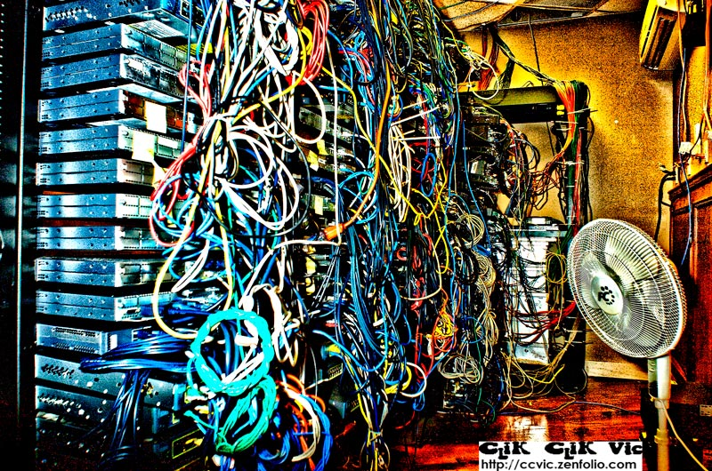 Photo of racks filled with Cisco Networking gear. Photo Credit Vincent Banial